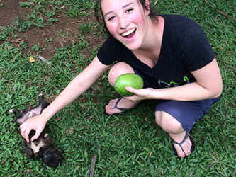 Student enjoying a puppy