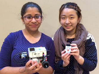 Students showing off robots