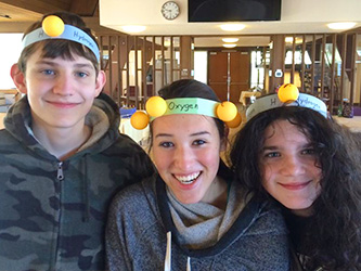Students showing off molecule headbands