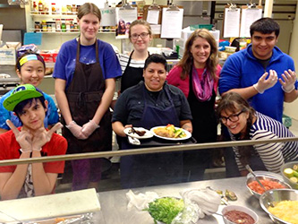 Teens making food for homeless youth as community service